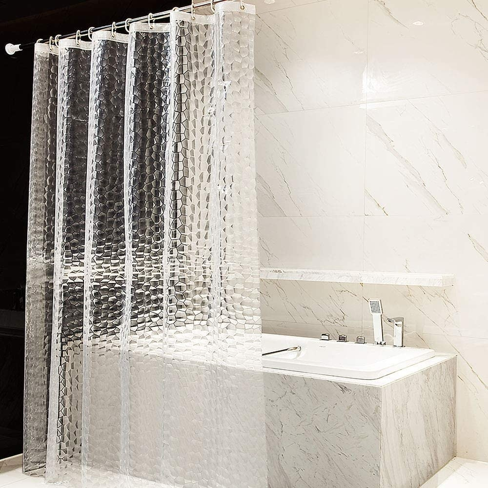 The shower curtain in front of a bathtub
