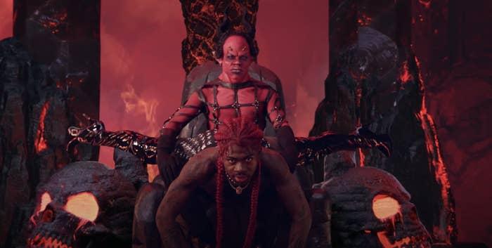 Lil Nas spread eagled over the devil