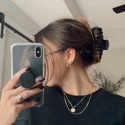 reviewer taking a selfie while wearing the black clip