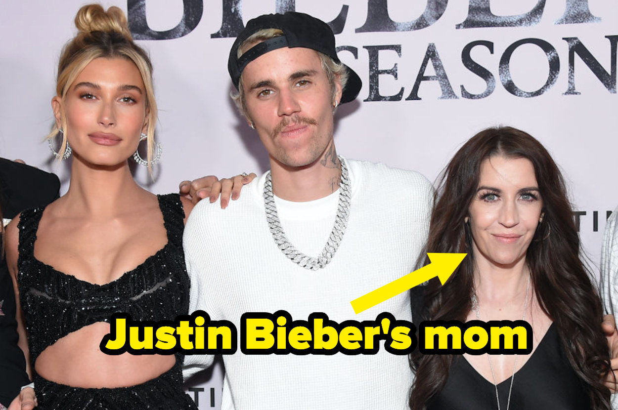 Justin taking a picture with his mother and wife