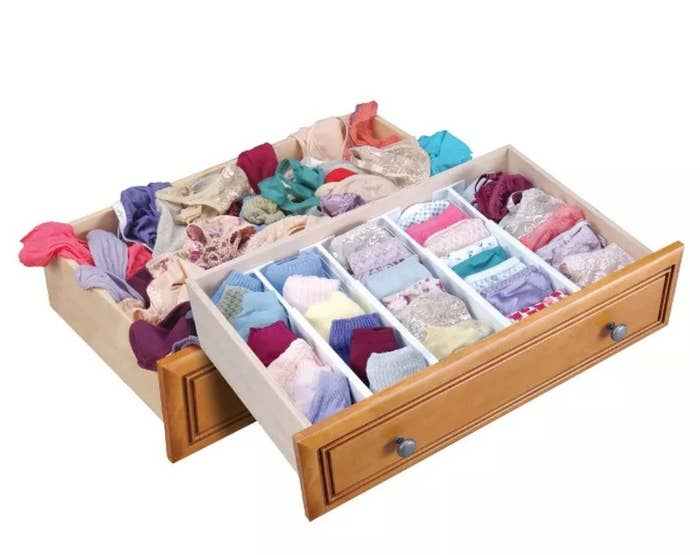A drawer organizer filled with underwear
