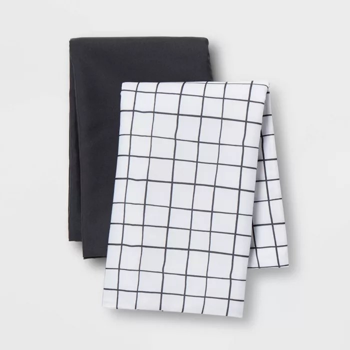 One black and one checkered pillowcase