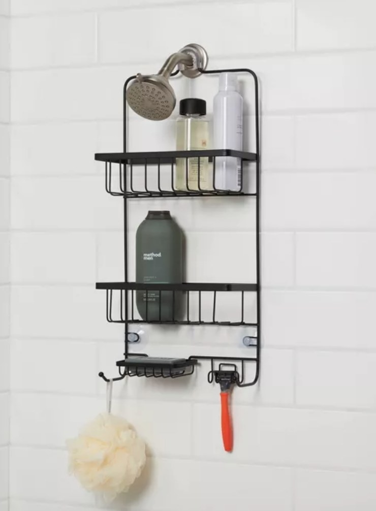 A black, rust-resistant shower caddy that hangs over the shower head and features 2 large baskets, a bar soap holder and 4 hanging hooks