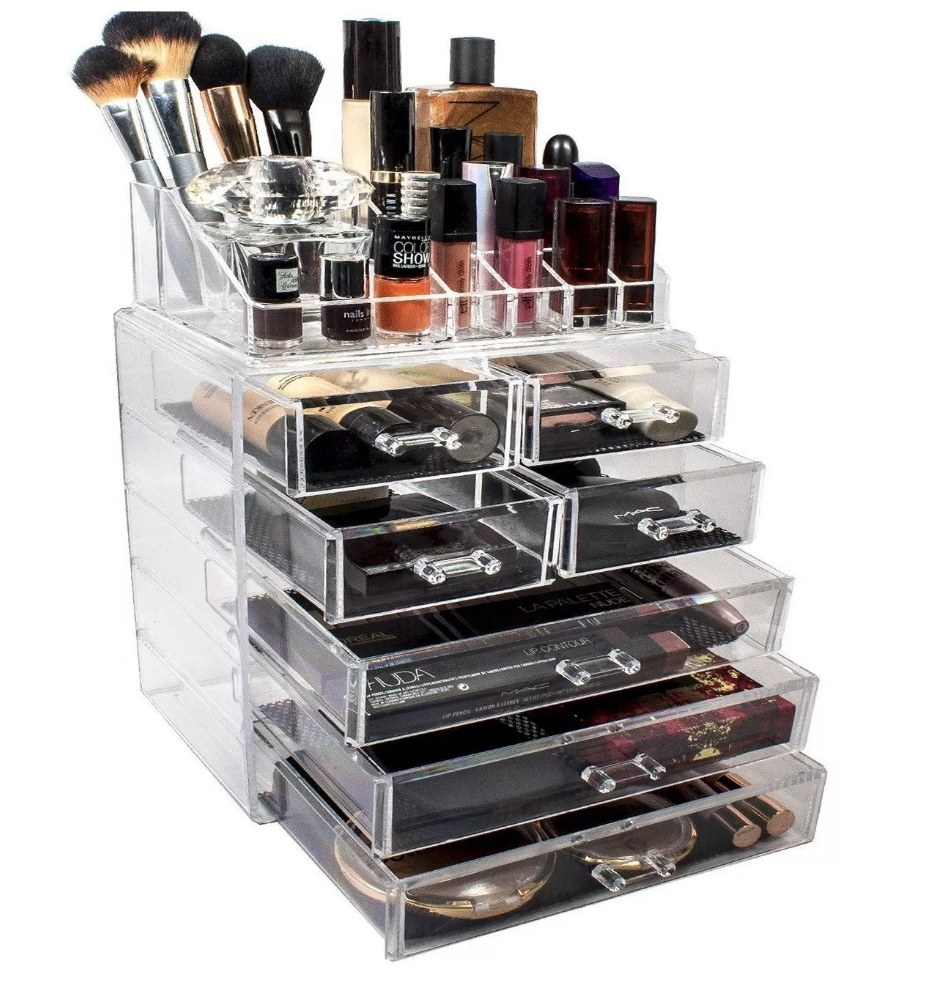 A makeup storage organizer with 7 drawers and top organizers filled with a variety of makeup products