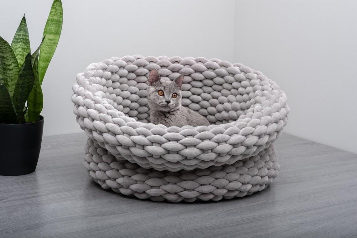 Cat inside large knit adjustable basket bed