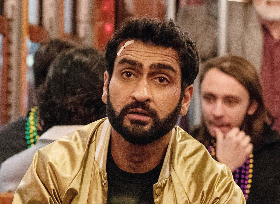 Kumail at a party with a bandage on his forehead