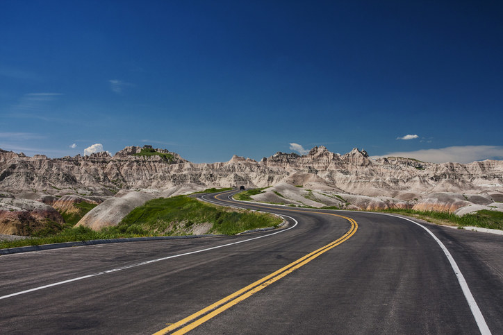 A view of the Badlands in North Dakota, featuring jagged rock formations