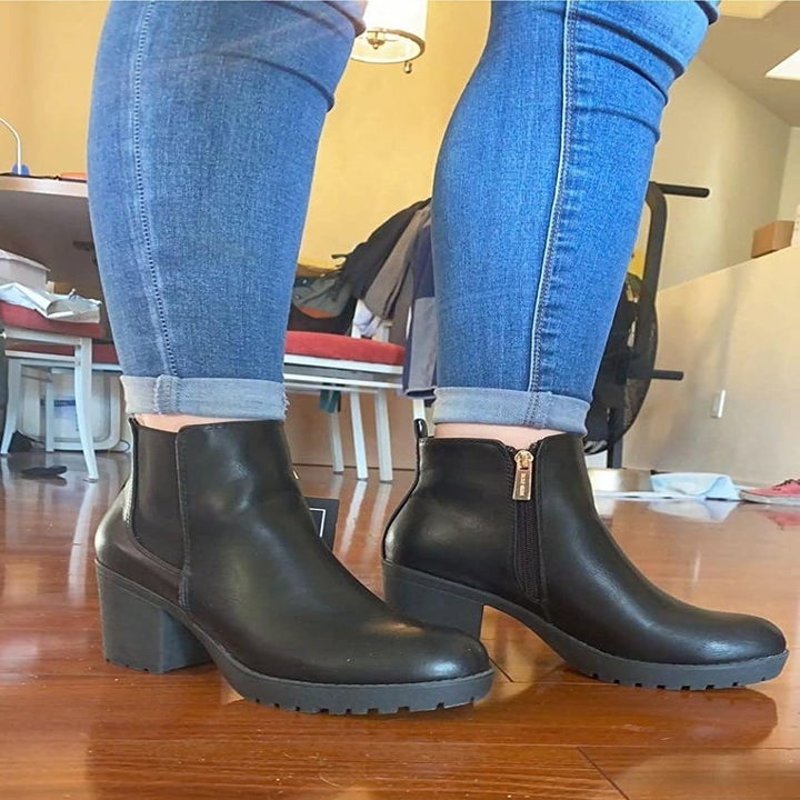 Reviewer wearing the black pair