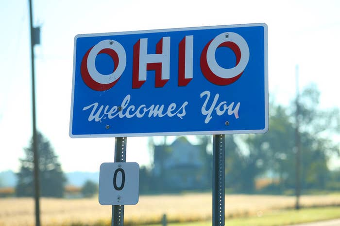 """A weathered road sign that reads """"Ohio welcomes you"""""""