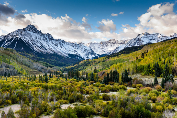 A panoramic view of the snowy Rocky Mountains