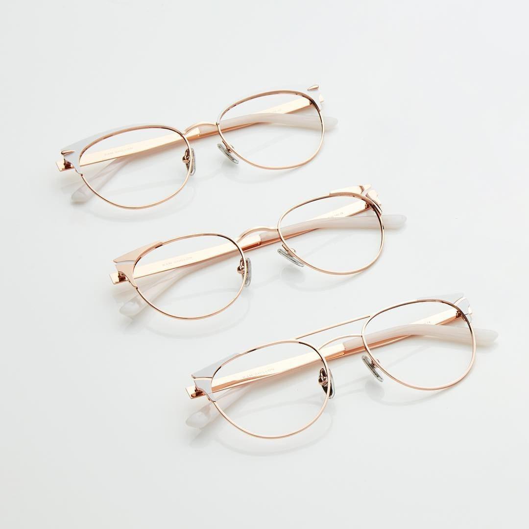 A flatlay of three eyeglass frames