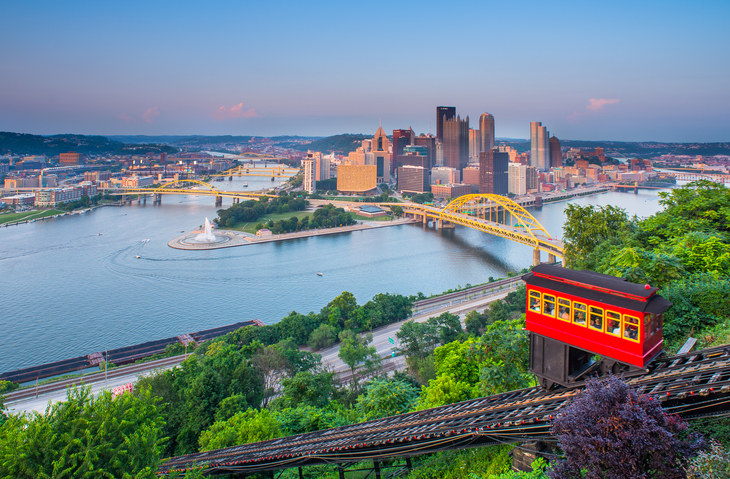 A funiclar in the foreground of a skyline view of Pittsburgh