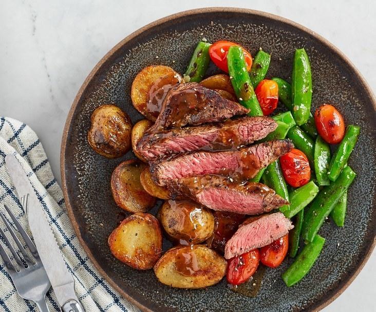steak with veggies and potatoes