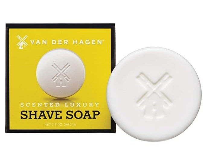 the bar soap box next to a round white bar with a windmill carved into it