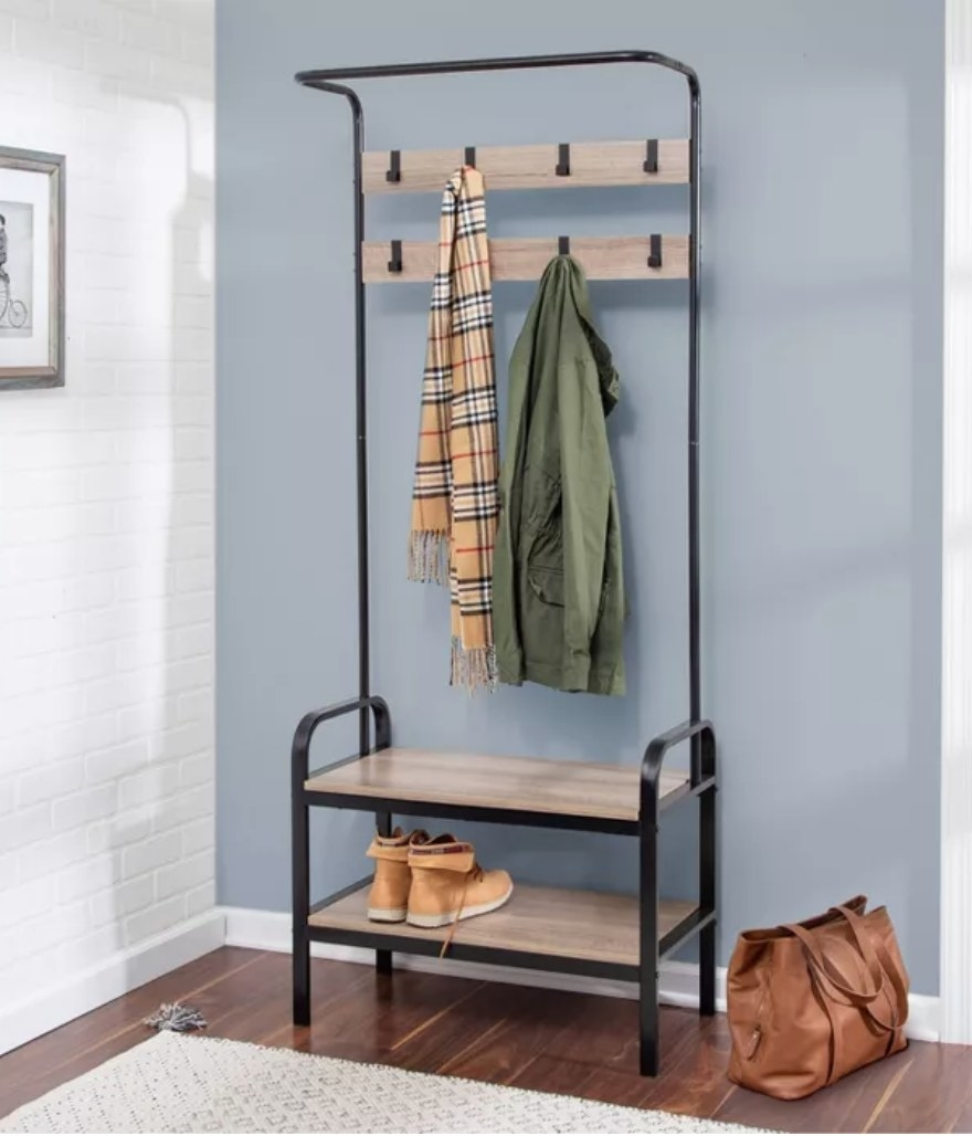 An entry rack with a bench, 8 hooks to hang coats, and a shoe rack that holds 4-6 pairs of shoes