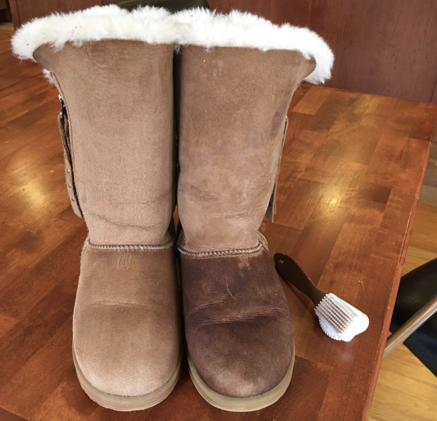 reviewer photo of Ugg boots, one with stains and the other looking new from the brush