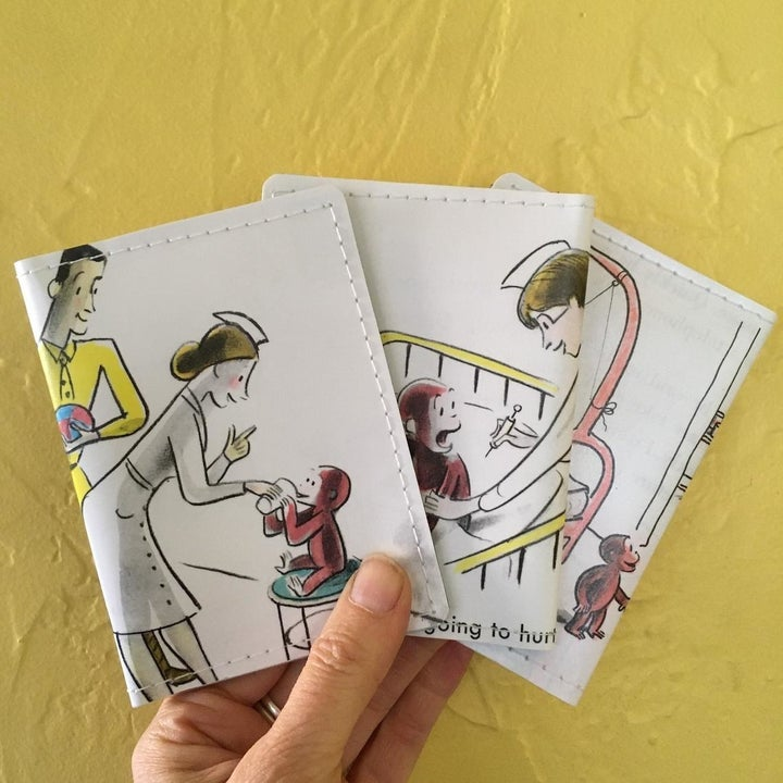 fold over case with illustration of curious george getting a shot