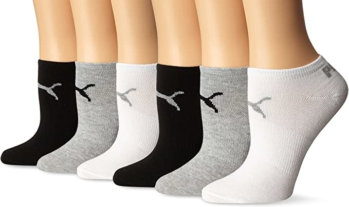 row of model feet in ankle height puma running socks