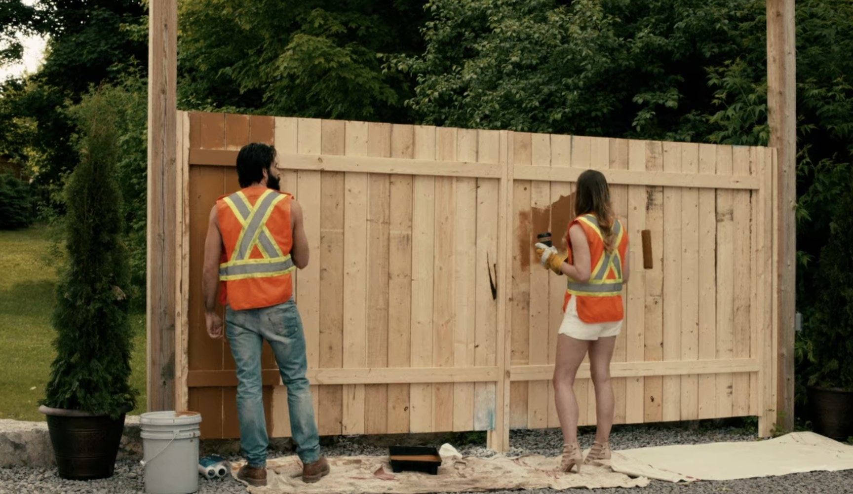 Alexis and Mudd painting fence