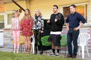 Schitt's Creek characters in front of motel