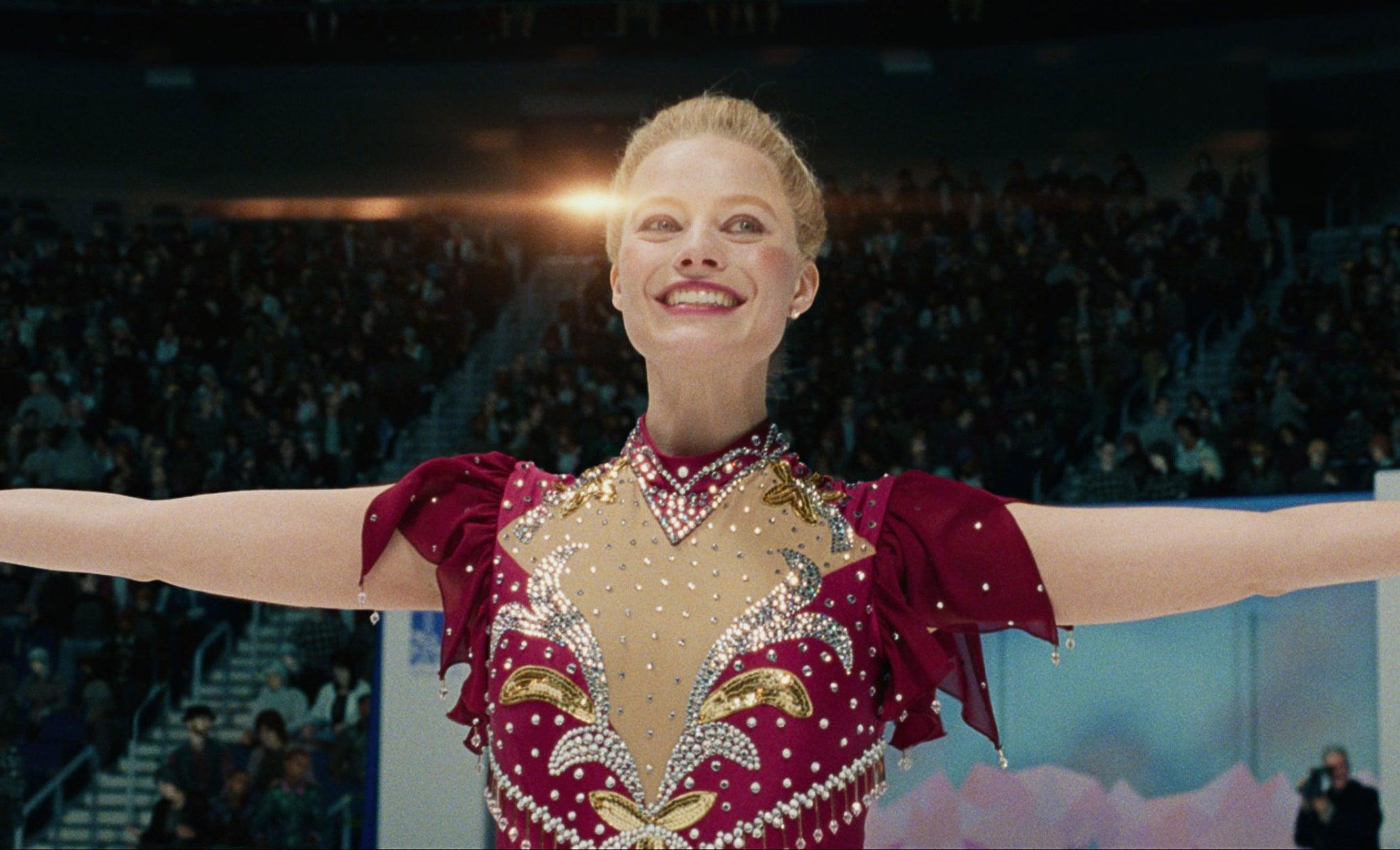 Margot Robbie as Tonya Harding smiling while skating