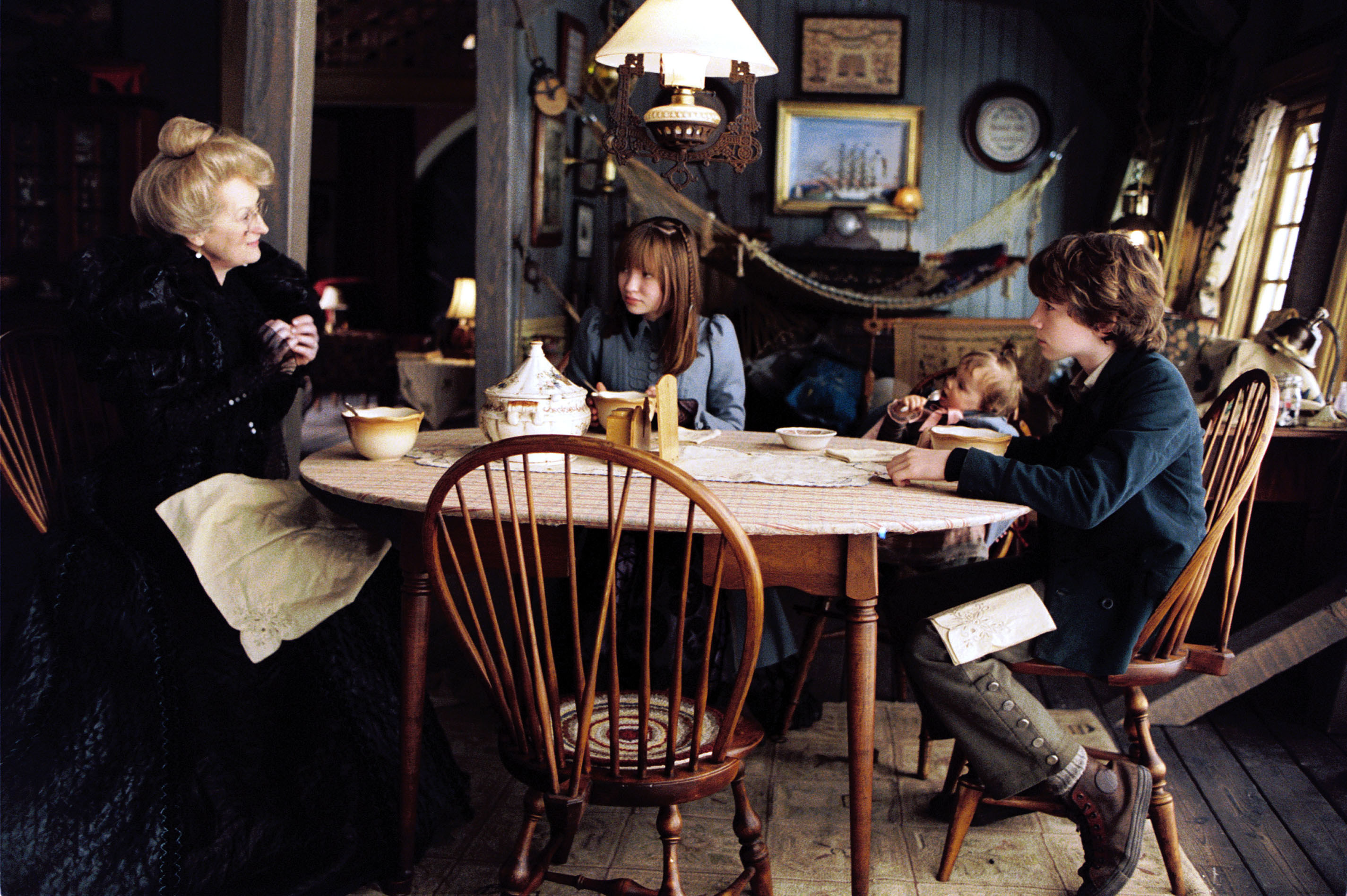 The Baudelaire orphans sit with their aunt, Josephine Anwhistle