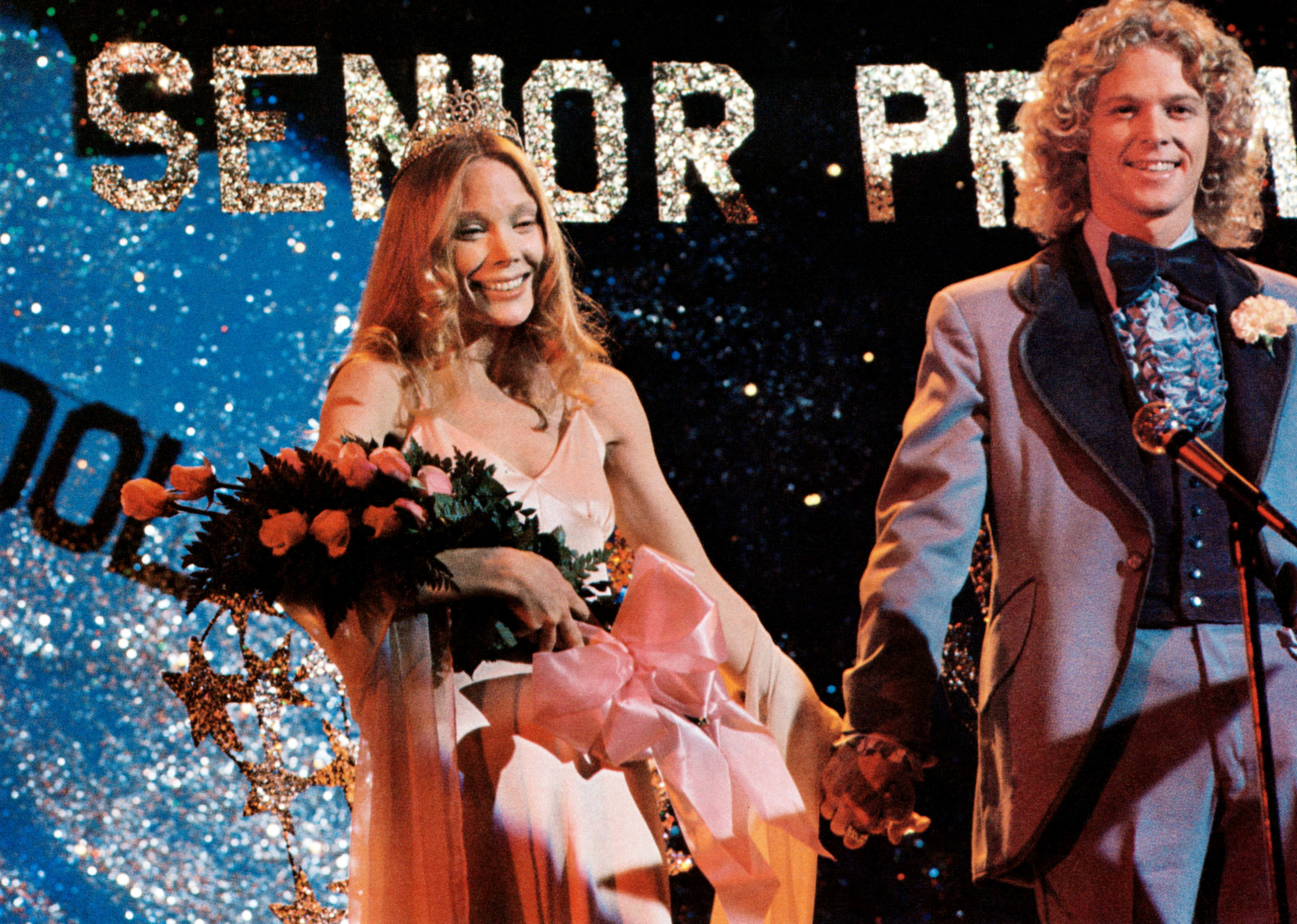 Carries stands onstage as she wins prom queen