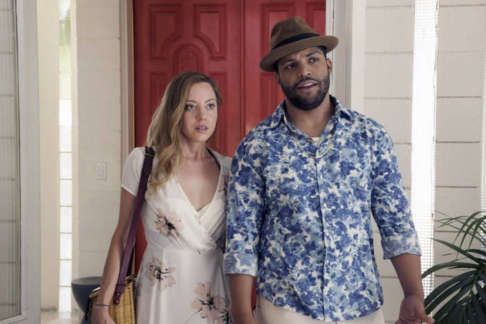 Aubrey Plaza and O'Shea Jackson Jr. walking while appearing to be talking