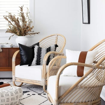 the pillows on two accent chairs