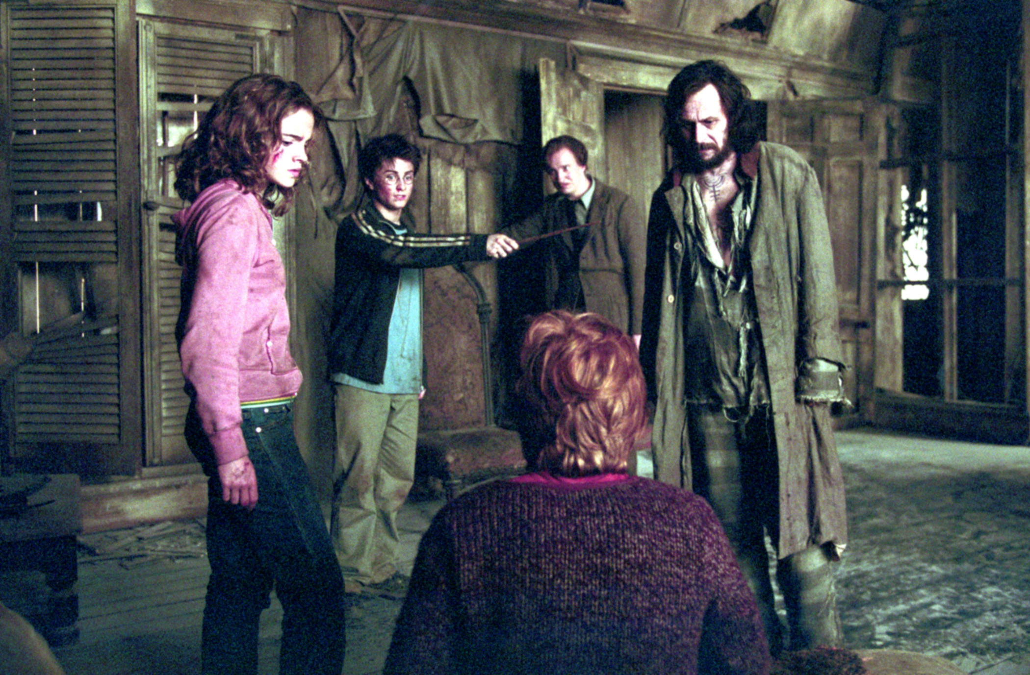 Harry, Hermione, Remus, Sirius, and Ron stand in the Shrieking Shack