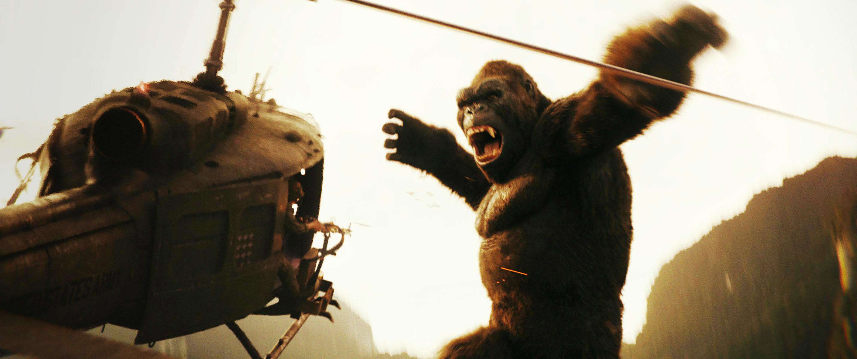 Kong jumps up to attack the helicopter