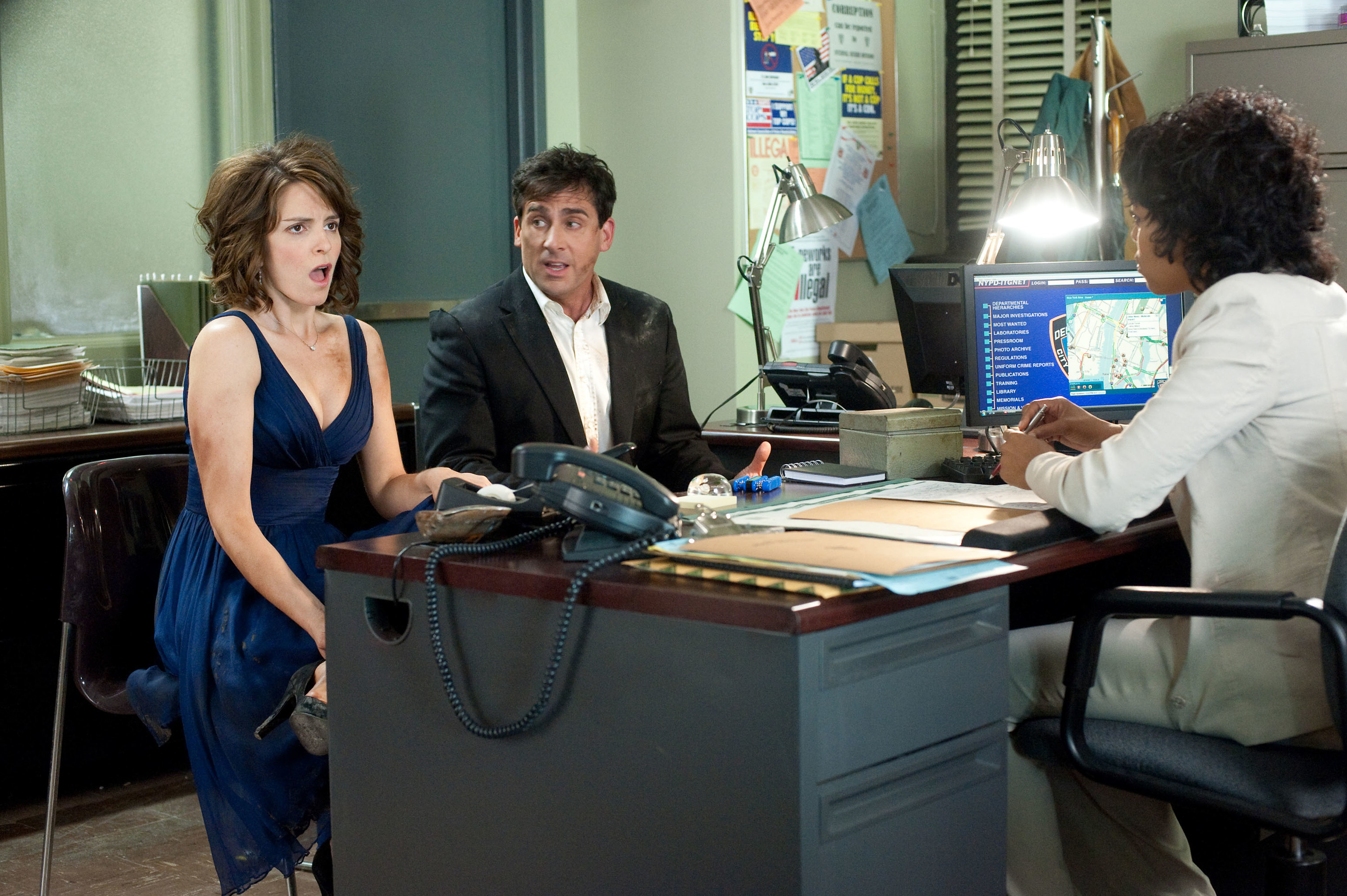 Tina Fey and Steve Carell appearing to look concerned while their outfits are ruined