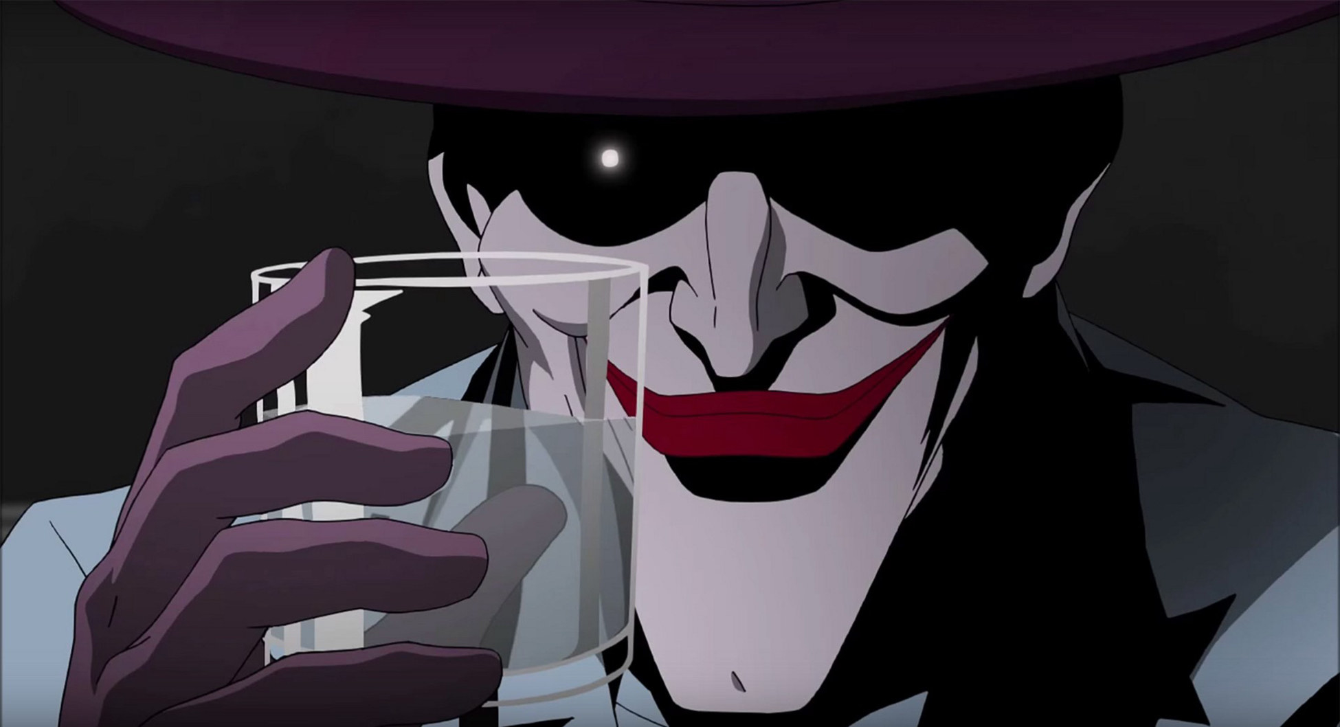 The Joker smiles and raises a glass