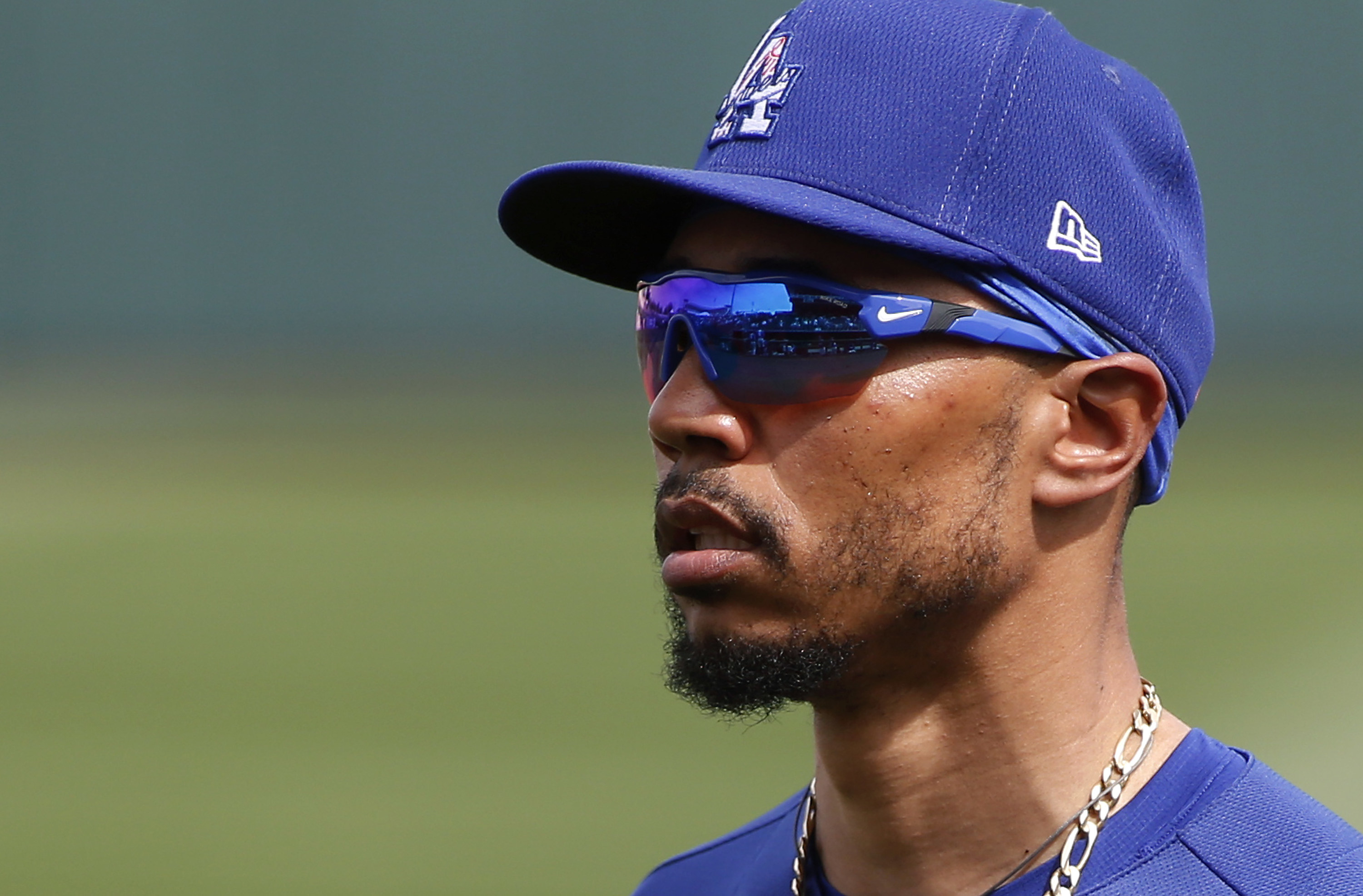 Present day Mookie Betts wearing shades and a Dodgers hat.