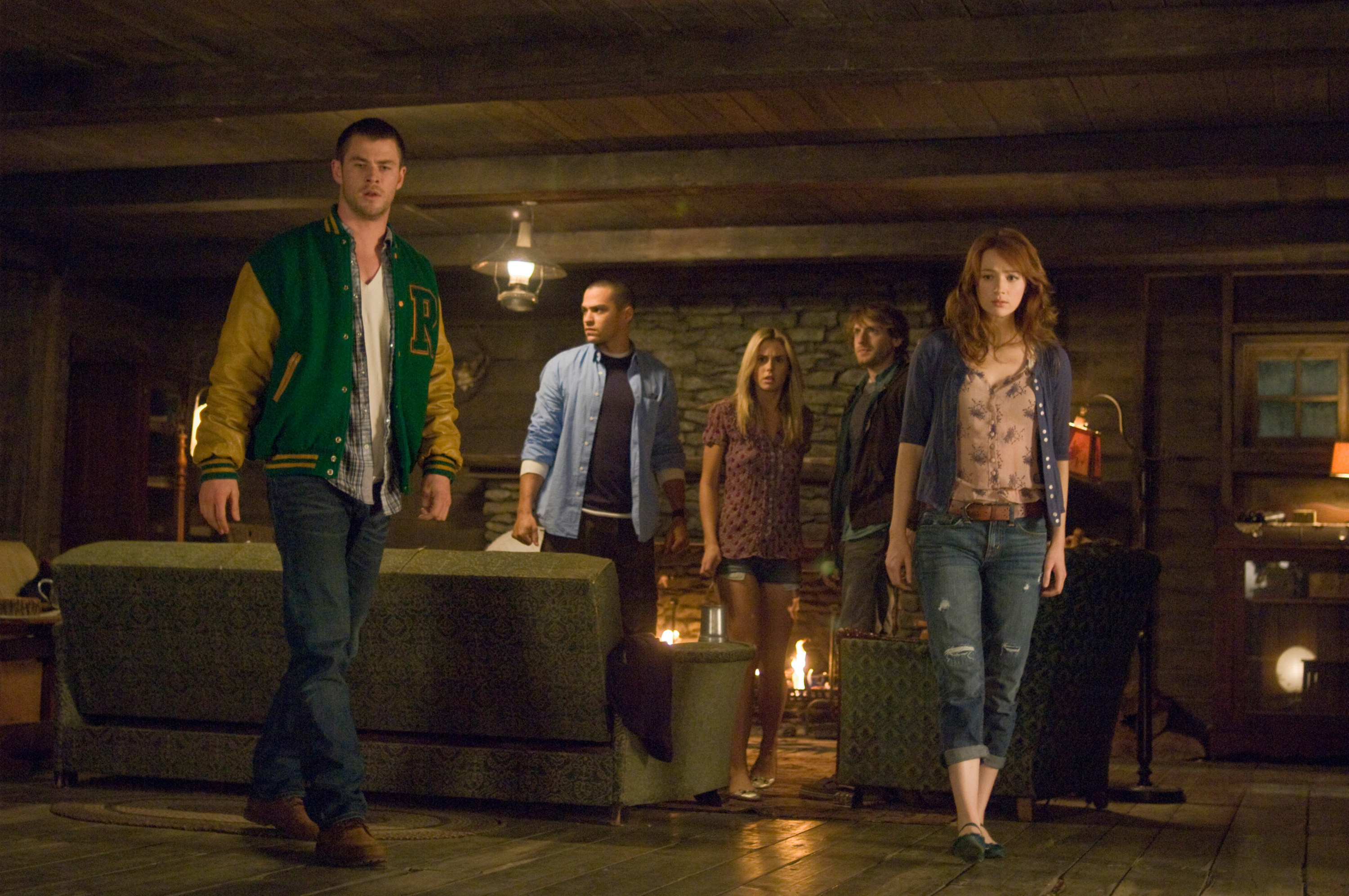 College students Dana, Jules, Curt, Holden, and Marty look around in The Cabin in the Woods
