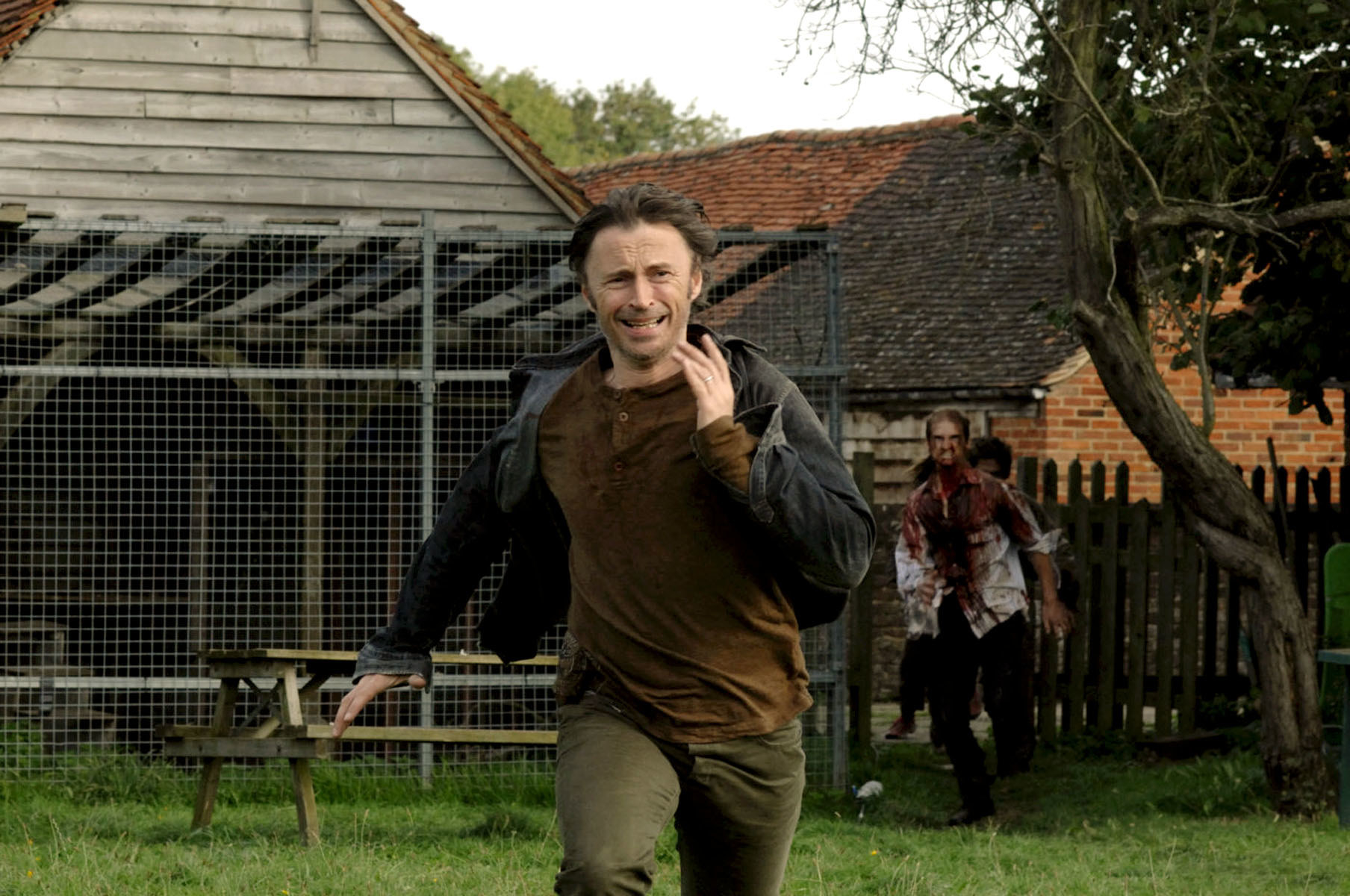 Don runs as he is chased by the infected