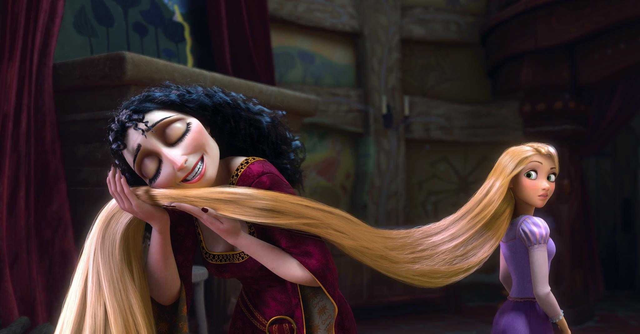 Mother Gothel rubs Rapunzel's hair against her face