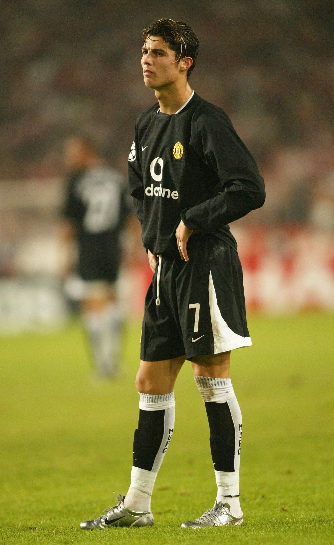 Young Cristiano Ronaldo in a black uniform.