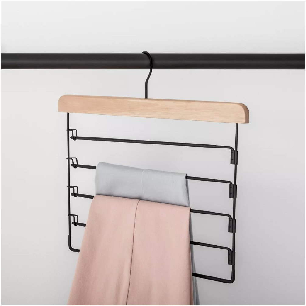 A 5 tier hanger with two pairs of pants displayed