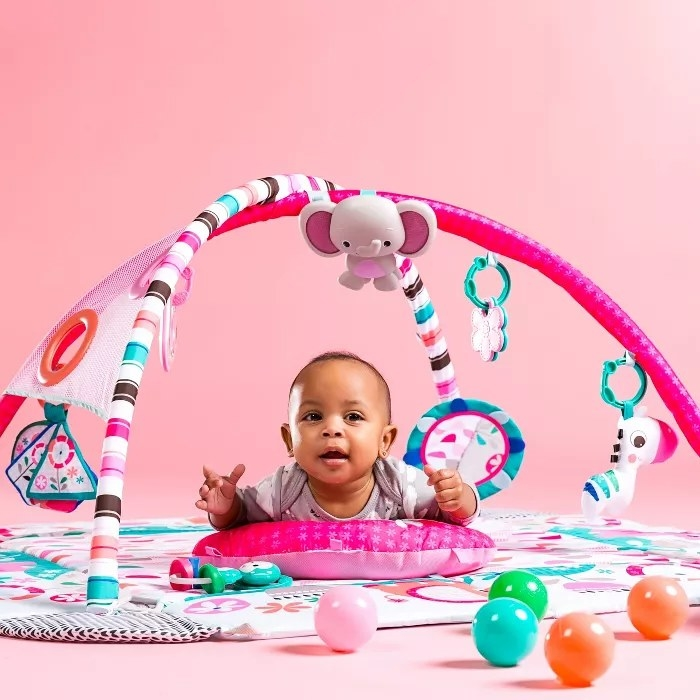 A baby in a play gym