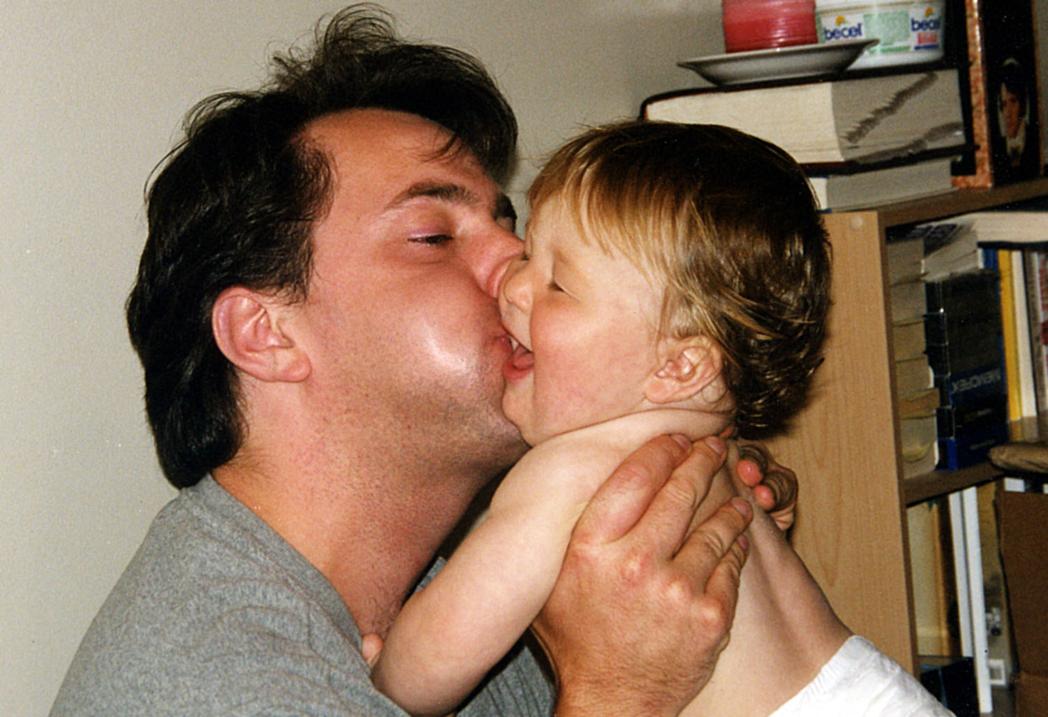 Andrew kissing his baby son, Zachary, on the cheek