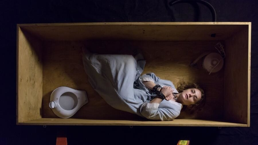 Collen Stan laying in a box