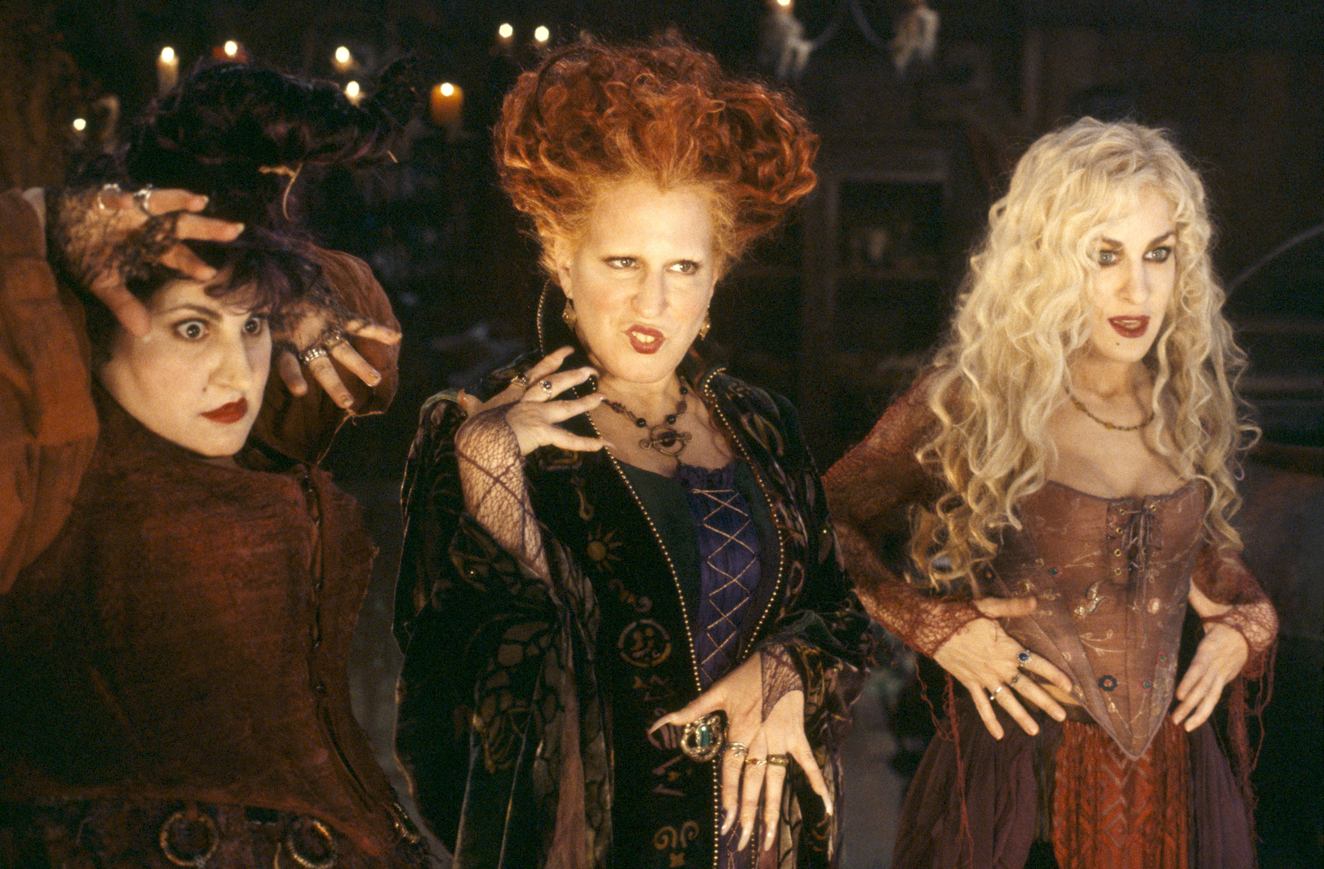 A photo of Kathy Najimy, Bette Midler, and Sarah Jessica Parker as the Sanderson Sisters