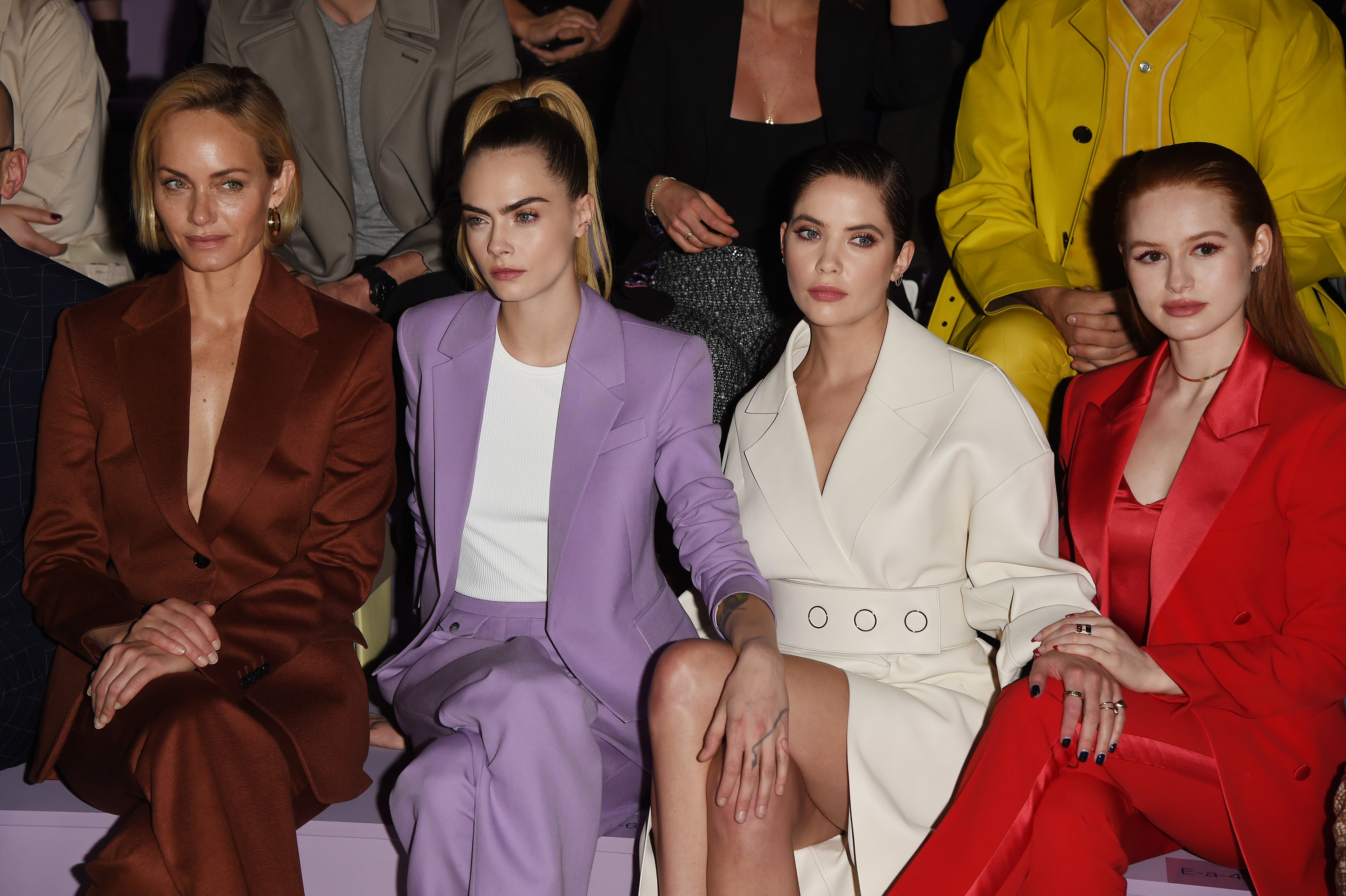 Ashley and Cara sit front row at a fashion show with celebrity friends