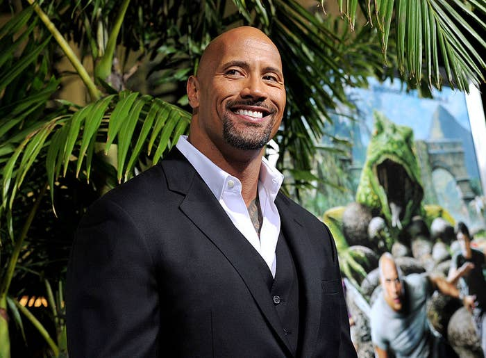 "Dwayne Johnson arrives at the premiere of Warner Bros. Pictures' ""Journey 2: The Mysterious Island"" at the Chinese Theater on February 2, 2012 in Los Angeles, California"