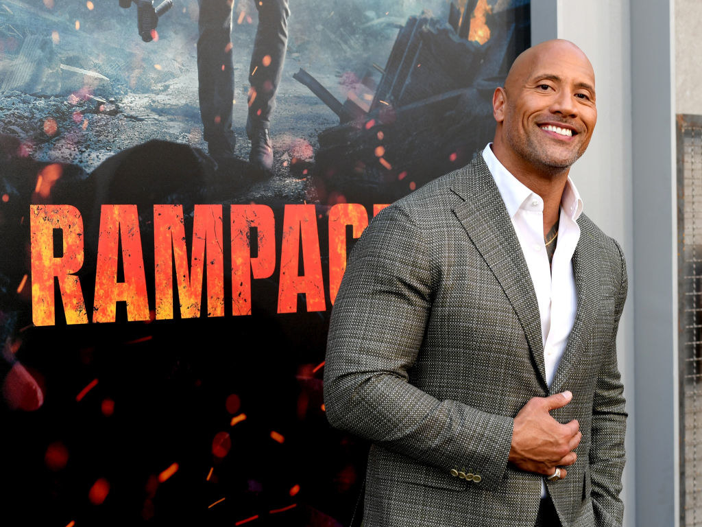 "Dwayne Johnson arrives at the premiere of Warner Bros. Pictures' ""Rampage"" at the Microsoft Theatre on April 4, 2018 in Los Angeles, California"