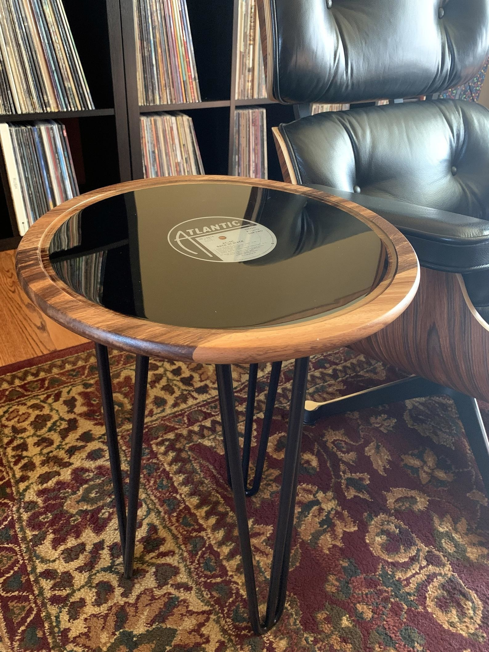 an atlantic record on top of the wooden table with hairpin legs