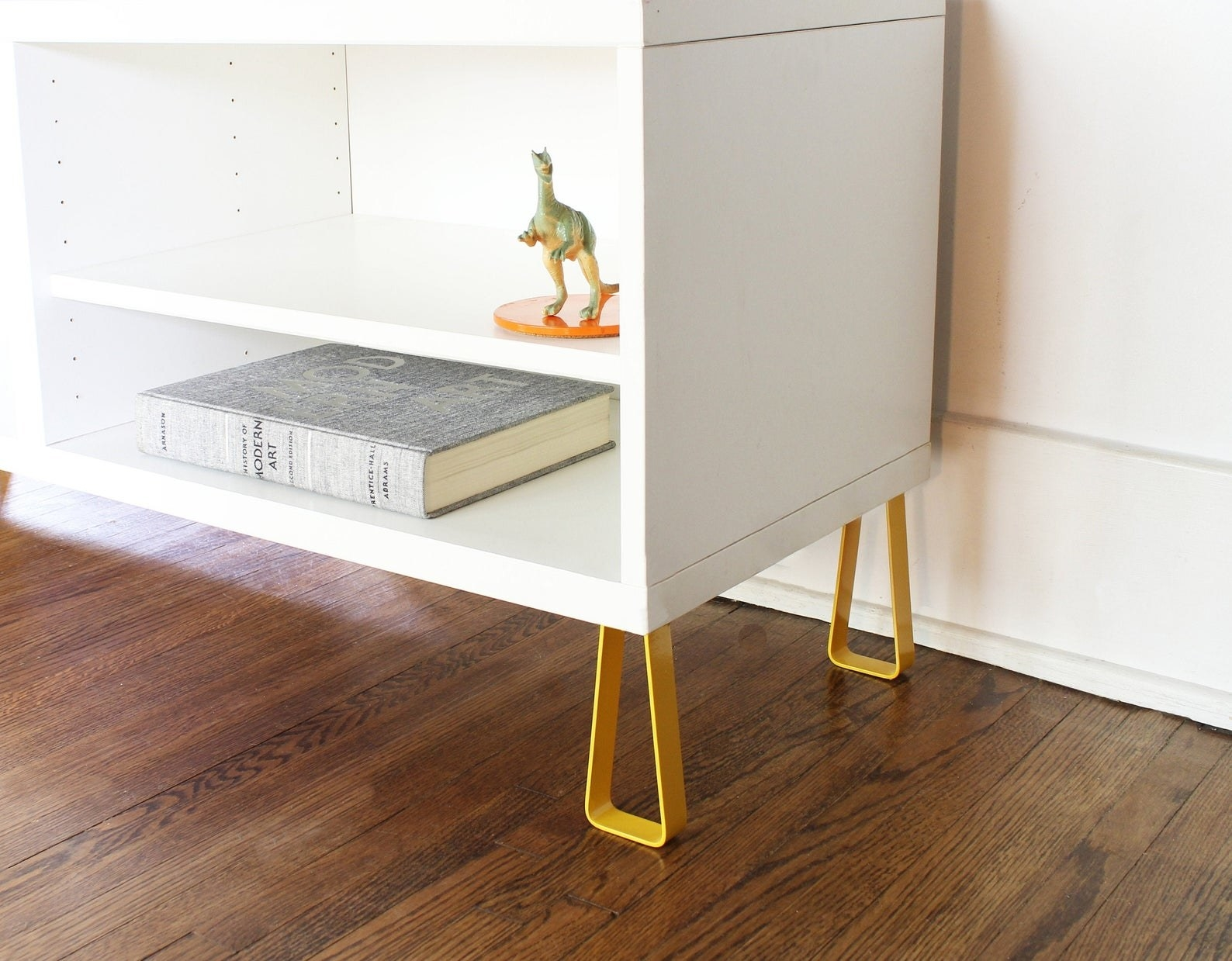 the yellow legs attached to a white ikea cabinet