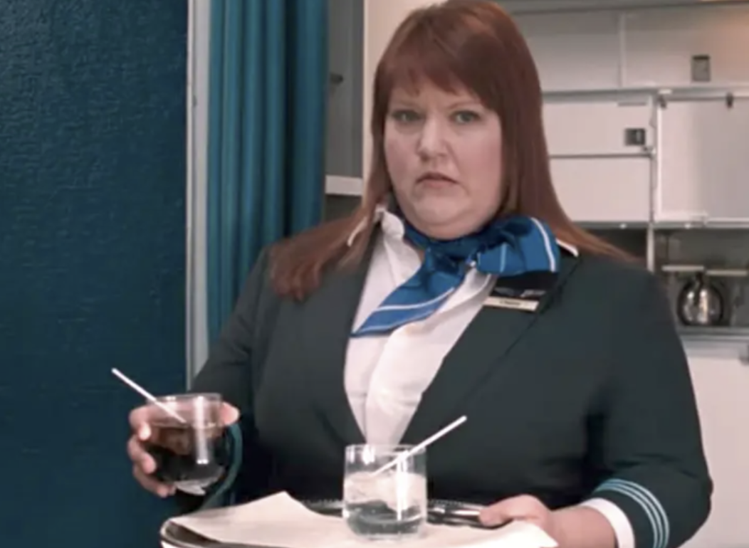 """A female flight attendant looking shocked in the movie """"Bridesmaids"""""""
