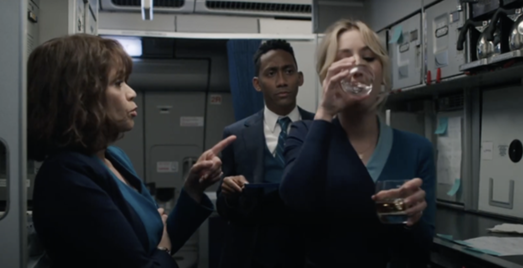 """Kaley Cuoco's """"Flight Attendant"""" character drinking in the galley of a plane"""